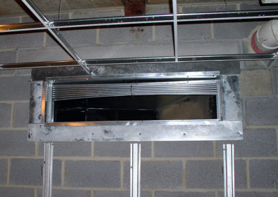 "In this picture, the installing contractor did not install the specified type of fire damper. By installing an ""in air stream"" instead of ""out of airstream"" type of damper, the system pressure drop and noise level has been greatly increased."