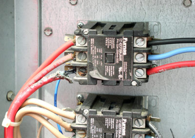 In this photograph, the line side connections of this heater contactor are loose, and caused overheating of the contactor and the conductors. Proper maintenance of the equipment would have prevented this problem.